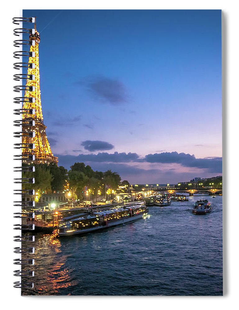 1889 Exposition Spiral Notebook featuring the photograph View Of The Eiffel Tower During Sunset From The Scene River by PorqueNo Studios