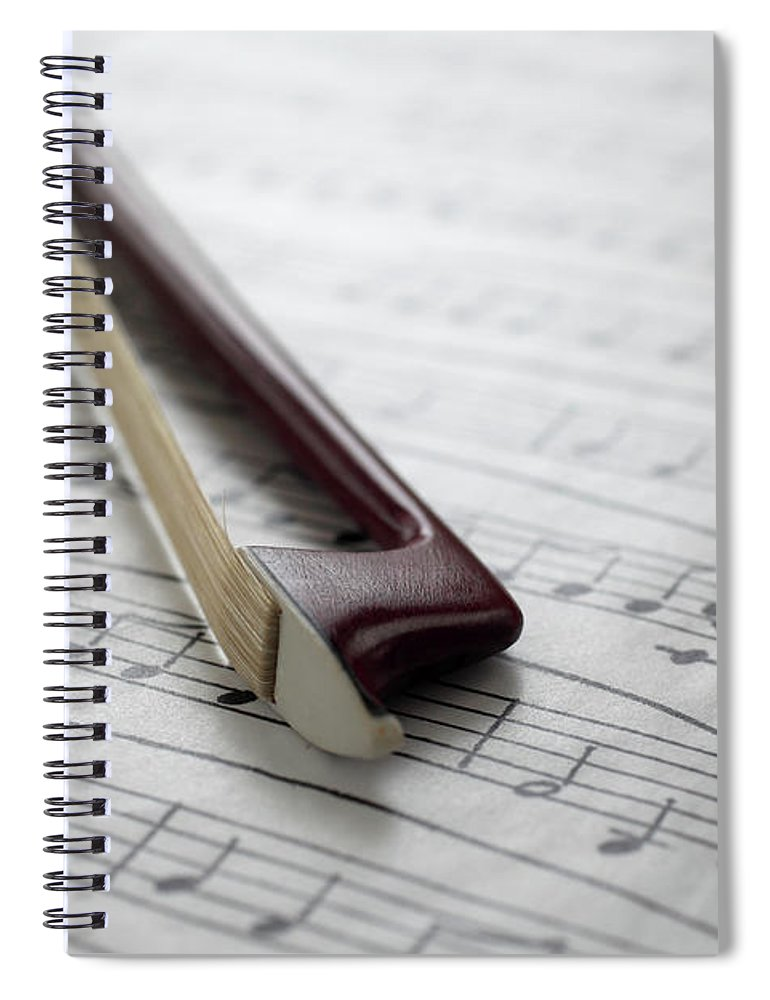 Sheet Music Spiral Notebook featuring the photograph Violin Bow On Music Sheet by Daniel Allan