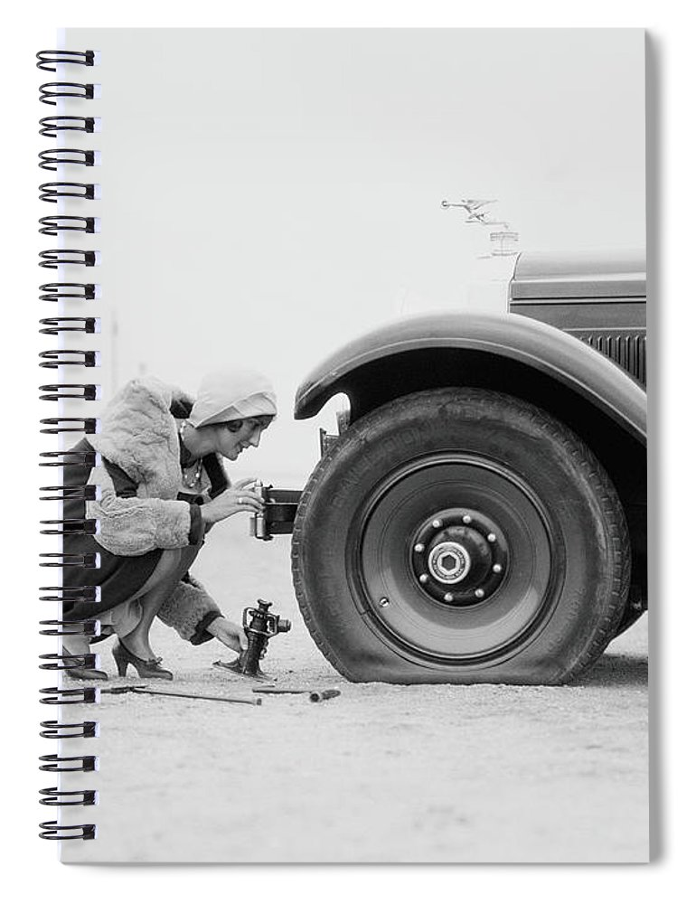 People Spiral Notebook featuring the photograph Woman Changing Flat Tire On Car by H. Armstrong Roberts