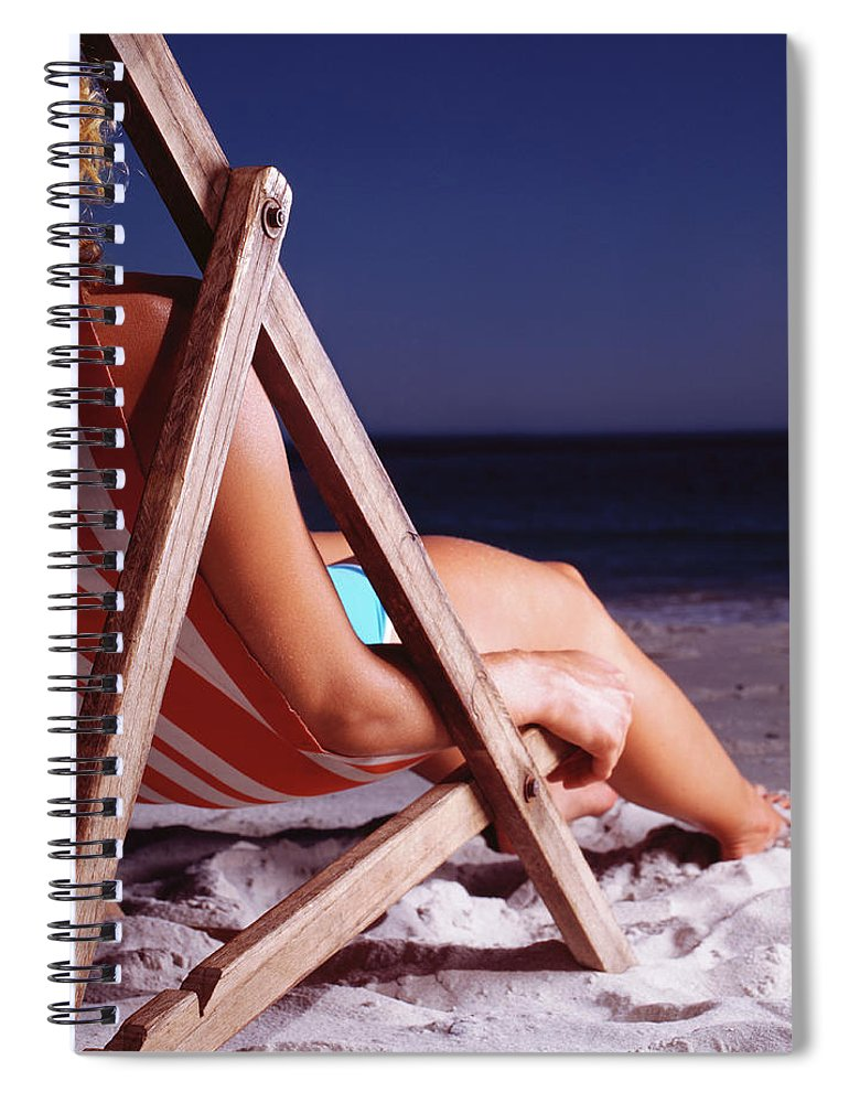 25-29 Years Spiral Notebook featuring the photograph Woman In Deck Chair On Beach, Close Up by Kelvin Murray