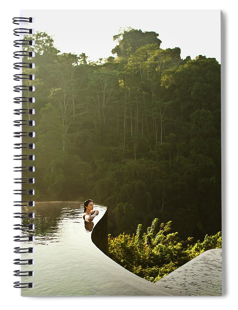 Tropical Rainforest Spiral Notebook featuring the photograph Woman In Infinity Pool At Sunrise. Bali by Matthew Wakem