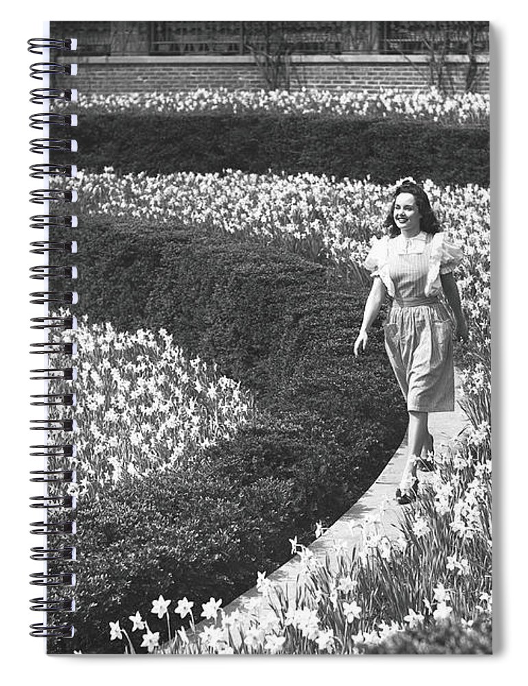 Flowerbed Spiral Notebook featuring the photograph Woman Walking On Flowerbed, B&w by George Marks