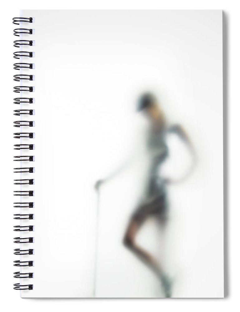 White Background Spiral Notebook featuring the photograph Woman With Golf Club Defocussed by Symphonie