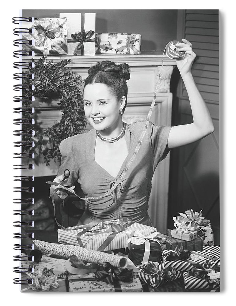 Human Arm Spiral Notebook featuring the photograph Woman Wrapping Christmas Presents In by George Marks