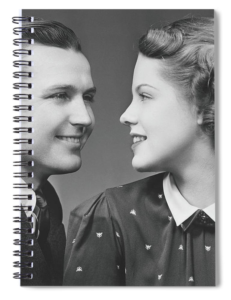 Young Men Spiral Notebook featuring the photograph Young Couple Looking In Eyes In Studio by George Marks