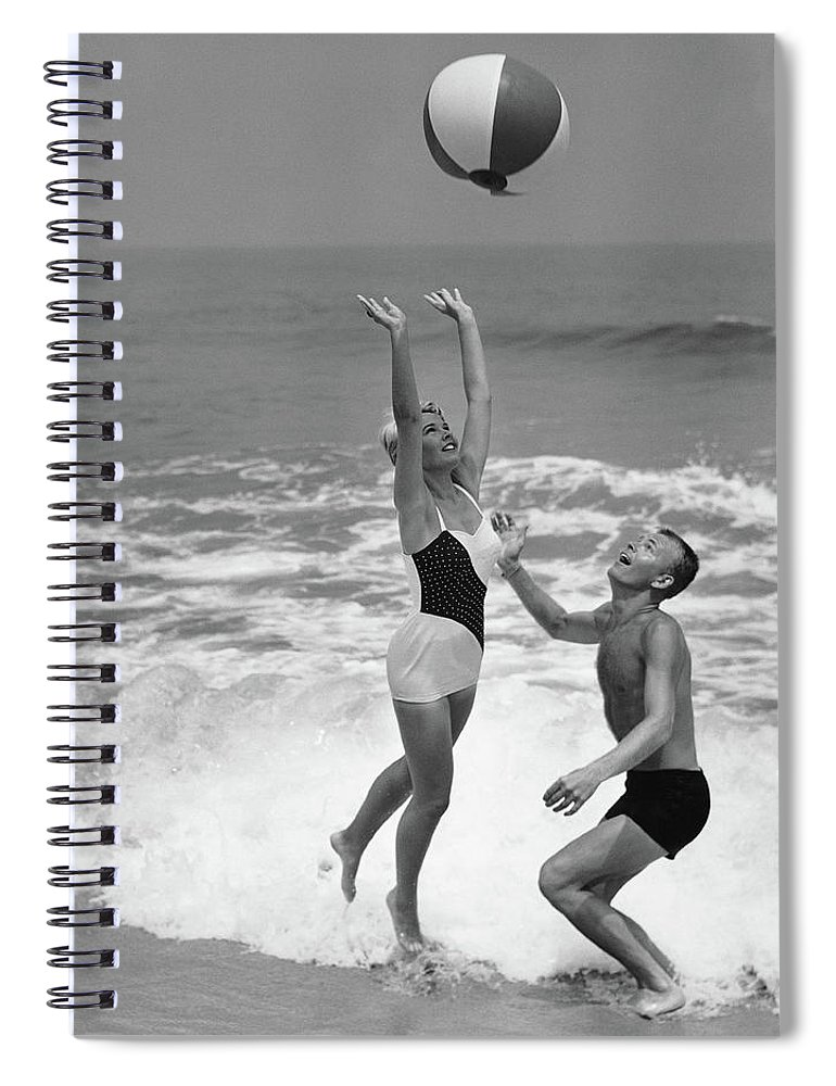 Young Men Spiral Notebook featuring the photograph Young Couple Playing With Beach Ball At by Stockbyte