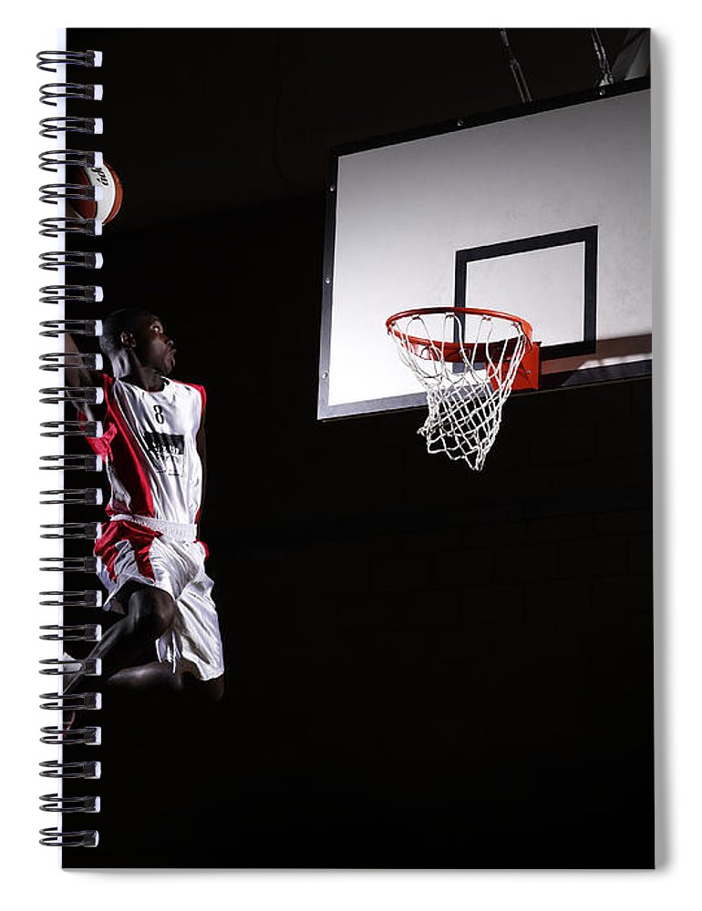 Human Arm Spiral Notebook featuring the photograph Young Man In The Air About To Dunk The by Compassionate Eye Foundation/steve Coleman/ojo Images Ltd