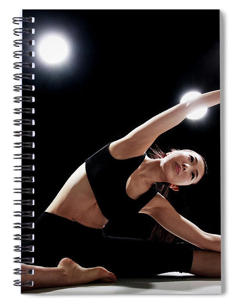 People Spiral Notebook featuring the photograph Young Woman Stretching by Runphoto
