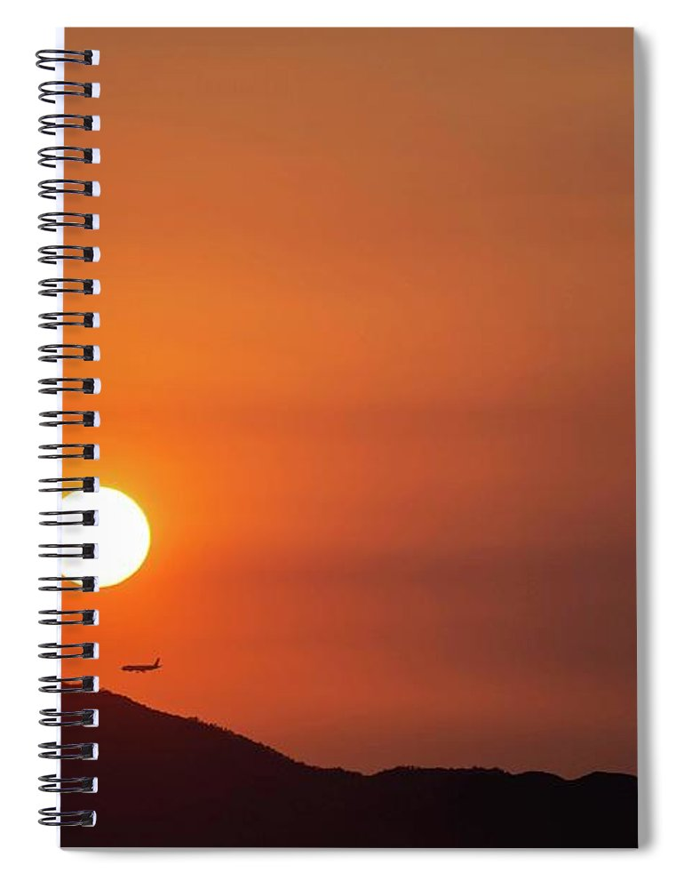 Sunset Spiral Notebook featuring the photograph Red sunset and plane in flight by Hannes Roeckel