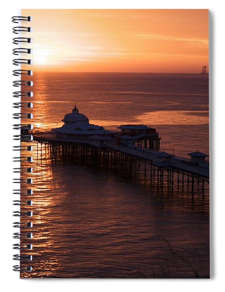 Piers Spiral Notebook featuring the photograph Sunrise over Llandudno pier 2 by Christopher Rowlands