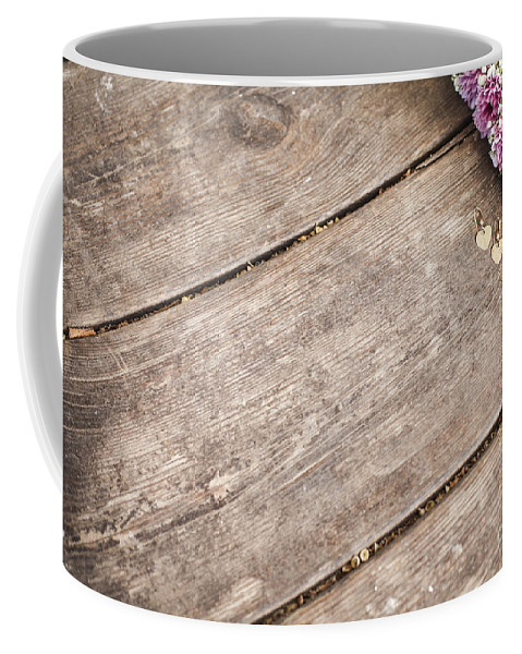 Simplicity Coffee Mug featuring the photograph Flower Frame On On Wood Background by Gal Eitan
