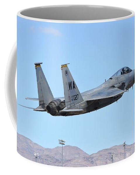 Nellis Air Force Base Coffee Mug featuring the photograph A U.s. Air Force F-15c Eagle Taking by Riccardo Niccoli