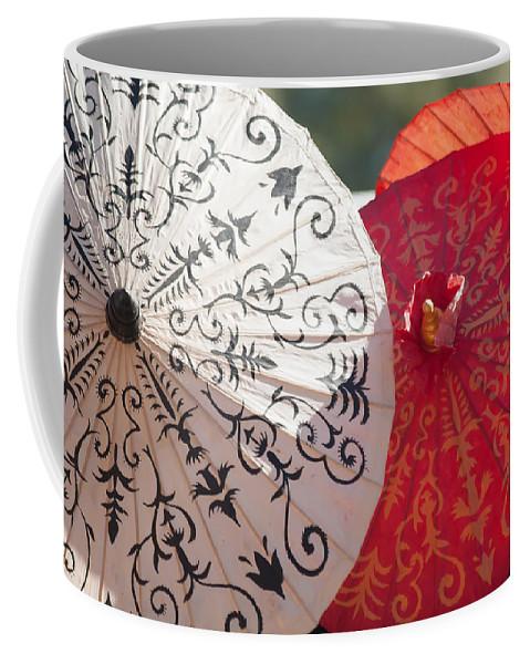 Art Coffee Mug featuring the photograph Asian Umbrellas by Alex Grichenko