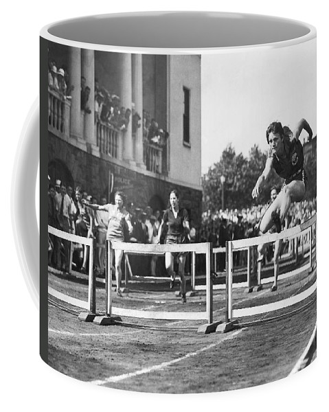 1931 Coffee Mug featuring the photograph Babe Didrikson High Hurdles by Underwood Archives