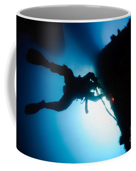 Commercial Diver Coffee Mug featuring the photograph Commercial Diver At Work by Hagai Nativ