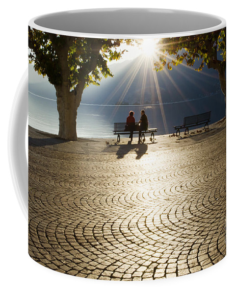 Couple Coffee Mug featuring the photograph Couple On A Bench by Mats Silvan