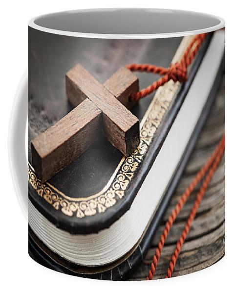 Cross Coffee Mug featuring the photograph Cross On Bible by Elena Elisseeva