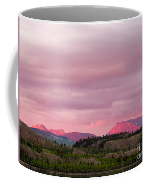 Above Coffee Mug featuring the photograph Distant Yukon Mountains Glowing In Sunset Light by Stephan Pietzko