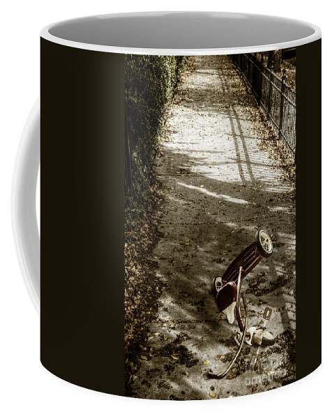 Tricycle Coffee Mug featuring the photograph Lost by Margie Hurwich