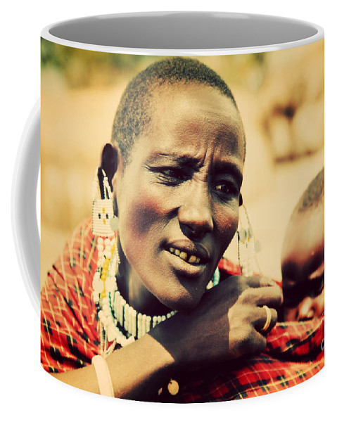 Africa Coffee Mug featuring the photograph Maasai Baby Carried By His Mother In Tanzania by Michal Bednarek