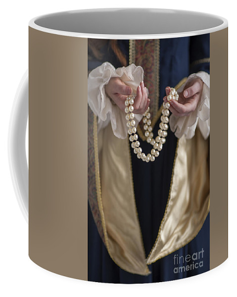 Woman Coffee Mug featuring the photograph Medieval Or Tudor Woman Holding A Pearl Necklace by Lee Avison