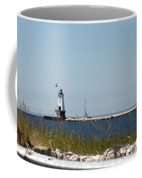 Ludington Coffee Mug featuring the photograph On The Water by Linda Kerkau