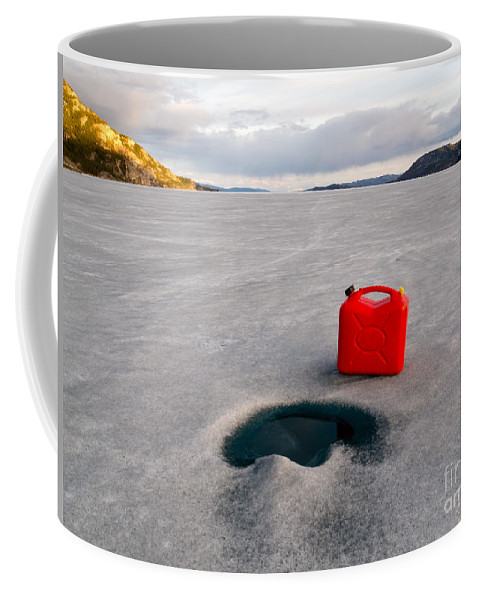 Can Coffee Mug featuring the photograph Red Jerrycan Lost On Frozen Lake Laberge Yukon T by Stephan Pietzko