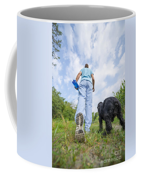 Woman Coffee Mug featuring the photograph Running by Mats Silvan