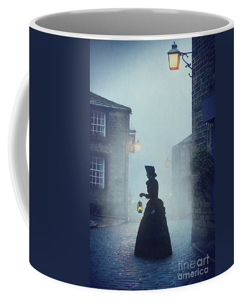 Victorian Coffee Mug featuring the photograph Victorian Woman With An Oil Lamp At Night On A Cobbled Street by Lee Avison