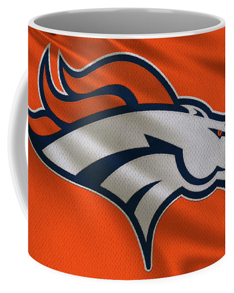 Broncos Coffee Mug featuring the photograph Denver Broncos Uniform by Joe Hamilton