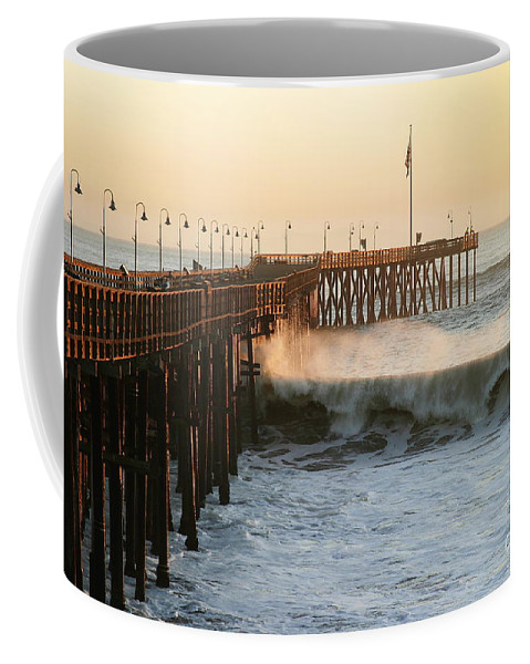 Storm Coffee Mug featuring the photograph Ocean Wave Storm Pier by Henrik Lehnerer