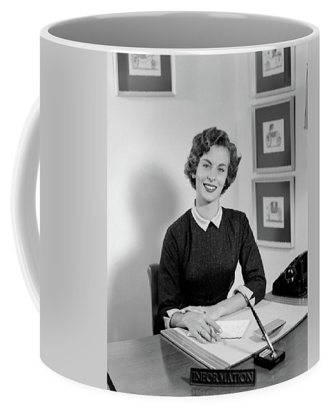 Photography Coffee Mug featuring the photograph 1950s Woman Sitting At Information Desk by Vintage Images