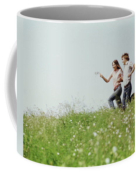 Photography Coffee Mug featuring the photograph 1970s Boy Girl Running Field by Vintage Images