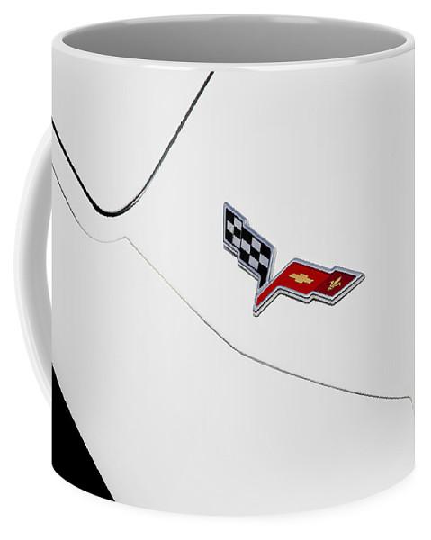 Corvette Coffee Mug featuring the photograph 1977 Corvette And New Corvette Emblem by Rich Franco