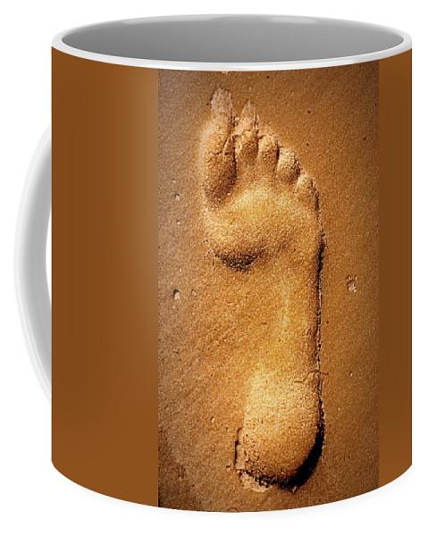 Footprint Coffee Mug featuring the photograph Footprint by Paul Wilford
