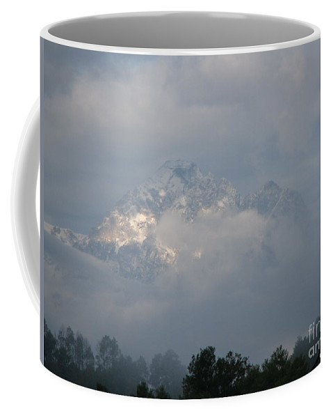 Rocky Mountains Coffee Mug featuring the photograph Out Of The Clouds by Greg Patzer