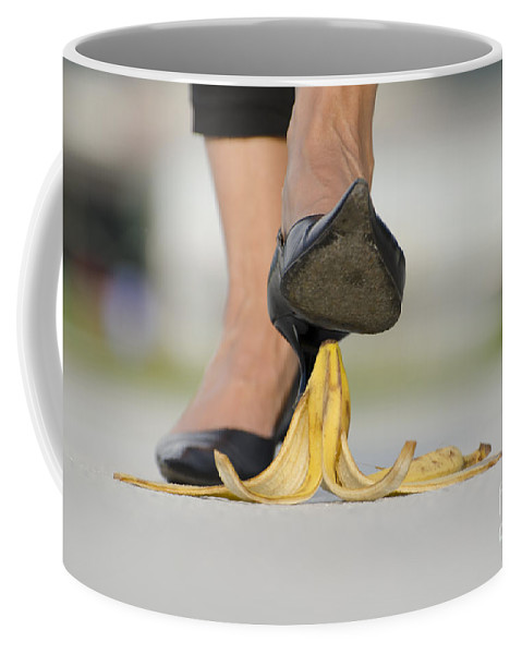 Banana Peel Coffee Mug featuring the photograph Walking On Banana Peel by Mats Silvan