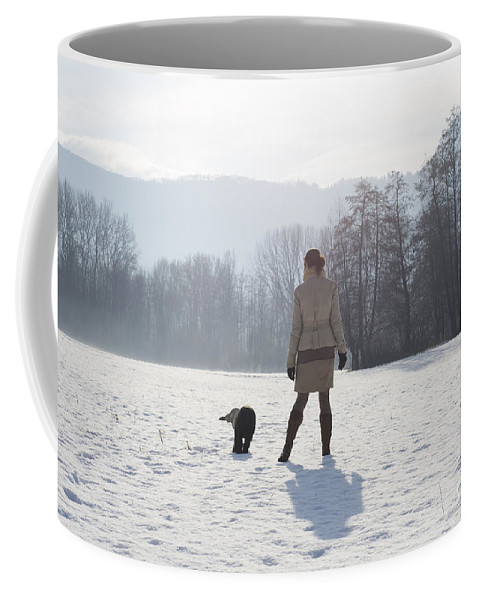 Woman Coffee Mug featuring the photograph Woman With Her Dog by Mats Silvan