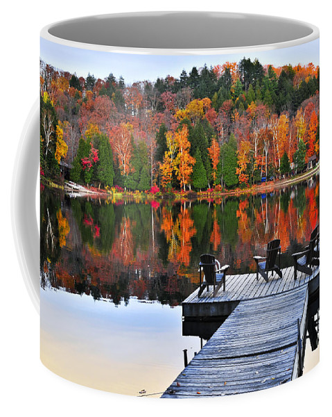 Lake Coffee Mug featuring the photograph Wooden Dock On Autumn Lake by Elena Elisseeva
