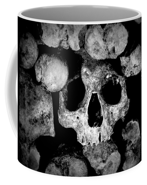 Paris Coffee Mug featuring the photograph Altered Image Of Skulls And Bones In The Catacombs Of Paris France by Richard Rosenshein