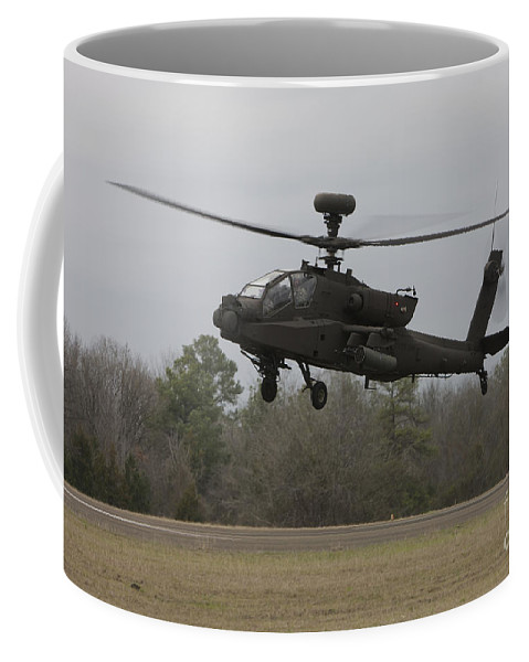 Aircraft Coffee Mug featuring the photograph An Ah-64 Apache Helicopter In Midair by Terry Moore