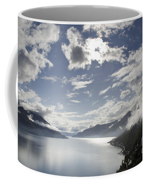 Lake Coffee Mug featuring the photograph Lake With Clouds by Mats Silvan