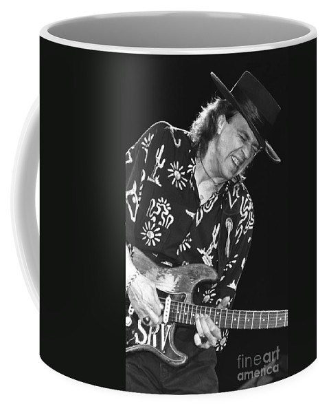 Blues Guitarist Coffee Mug featuring the photograph Guitarist Stevie Ray Vaughan by Concert Photos