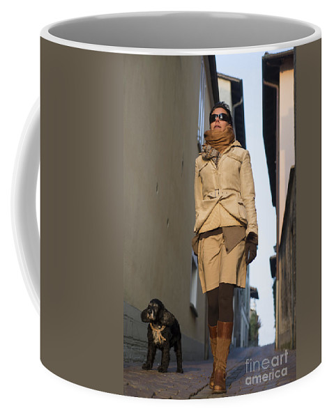 Woman Coffee Mug featuring the photograph Woman Walking With Her Dog by Mats Silvan