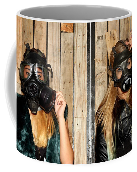 Two Coffee Mug featuring the photograph Women With Gasmasks by Henrik Lehnerer
