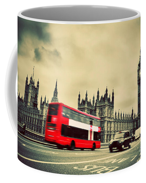 London Coffee Mug featuring the photograph London Uk Red Bus In Motion And Big Ben by Michal Bednarek