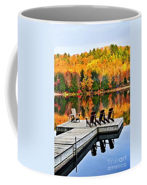 Lake Coffee Mug featuring the photograph Wooden Dock On Autumn Lake by Elena Elisseeva