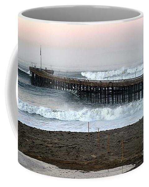 Sunrise Coffee Mug featuring the photograph Ocean Wave Storm Pier by Henrik Lehnerer
