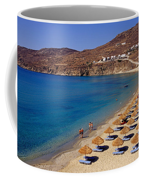 Mykonos; Mikonos; Beach; Elia; Greece; Hellas; Cyclades; Kyklades; Greek; Hellenic; Aegean; Island; Sand; Sea; People; Tourists; Swimming; Swim; Islands; Sunbathing; Suntanning; Suntan; Tanning; Relaxing; Relaxation; Umbrellas; Sunshades; Parasols; Sunbeds; Seabeds; Clear Water Coffee Mug featuring the photograph Elia Beach by George Atsametakis
