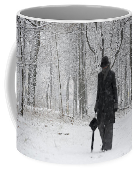 Woman Coffee Mug featuring the photograph Snowy Day by Mats Silvan